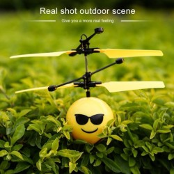 Cute Facial Expression Infrared Induction Flying Flash Disco LED Ball Toy Yellow